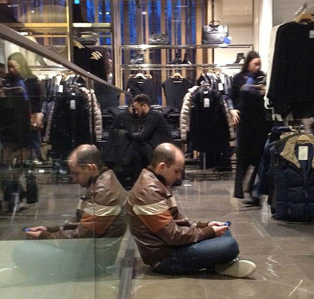husbands-waiting-on-their-shopping-wives-04