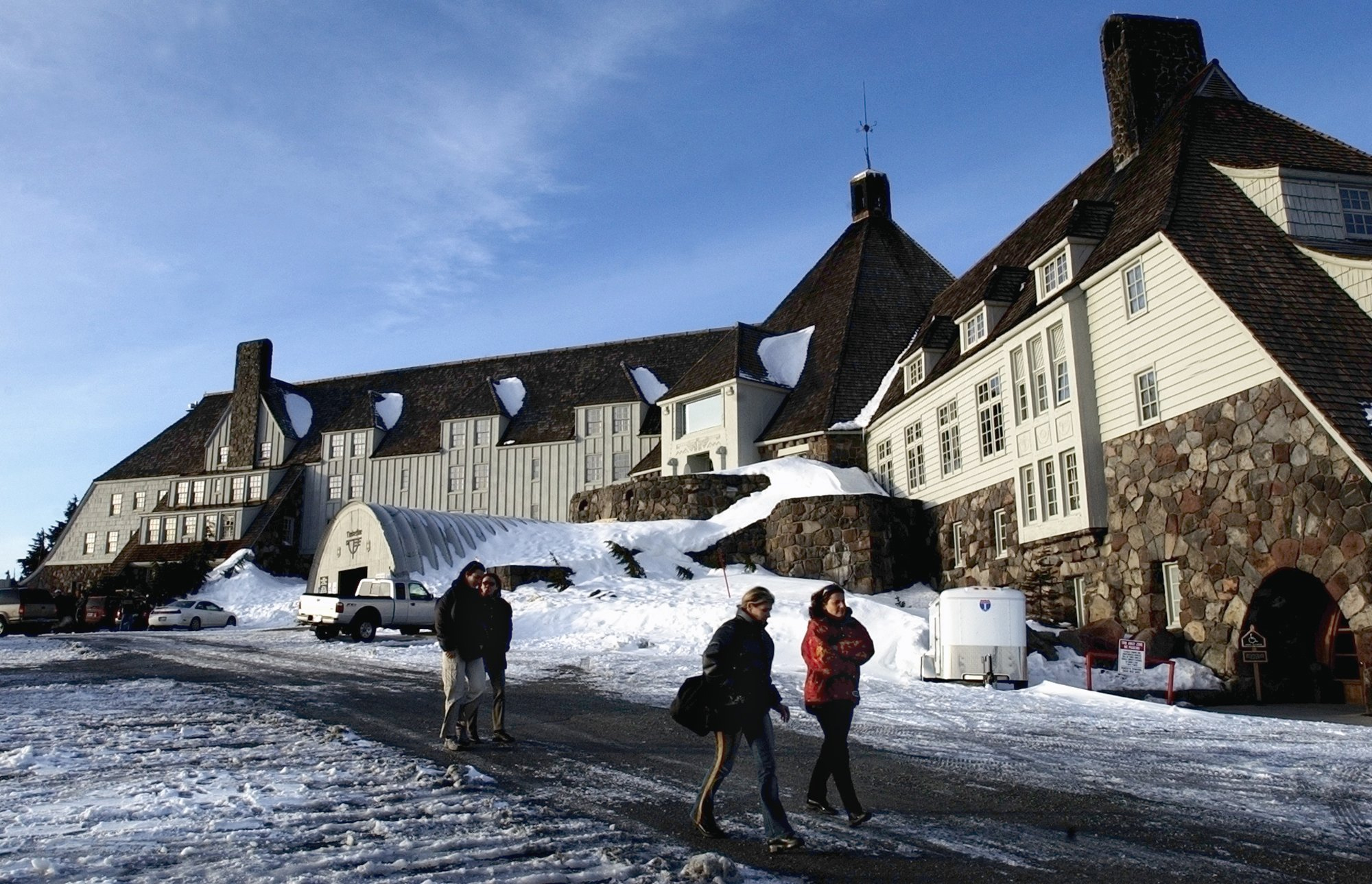 ** ADVANCE FOR WEEKEND OF DEC 27-28 ** Visitors stroll past the front of Timberline Lodge, on Mount Hood, Ore., Tuesday, Dec. 2, 2003. Timberline Lodge is on the National Register of Historic Places. (AP Photo/Statesman Journal, Timothy J. Gonzalez)
