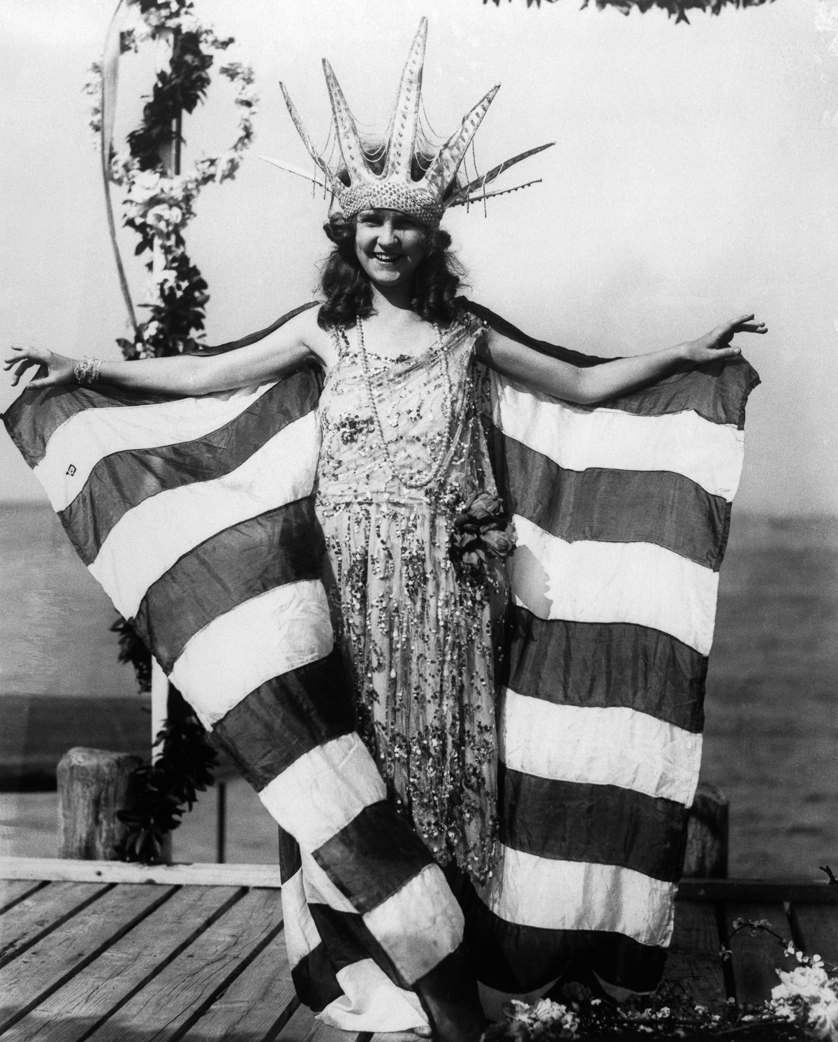 06 Sep 1922, Atlantic City, New Jersey, USA --- Original caption: Miss Margaret Gorman--Miss America--awaits the arrival of 'Neptune' on the yacht club dock, on the opening day of the National Beauty Pageant. --- Image by © Bettmann/CORBIS
