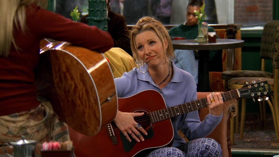 2. Phoebe Can't Play The Guitar For A Reason   8 Secrets About FRIENDS You Had No Idea About   Brain Berries