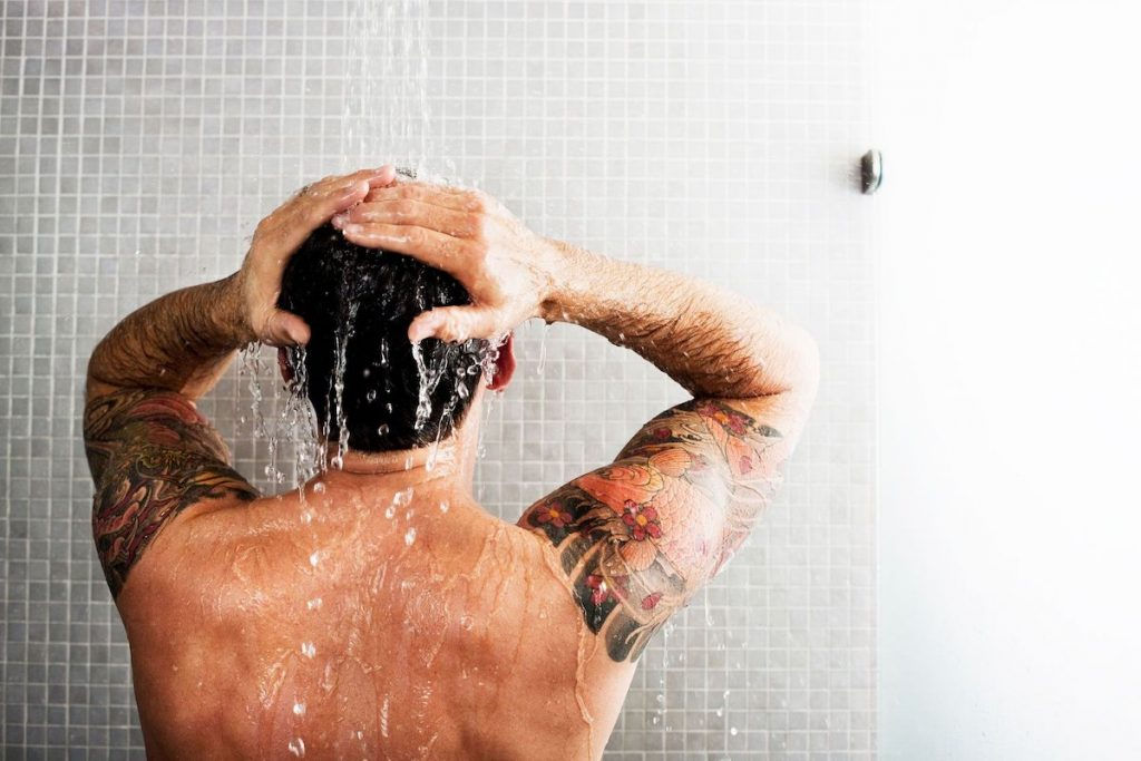 Exfoliating Shower | At-Home Spa Day Ideas for Men | Zestradar